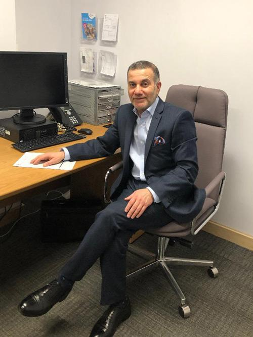 Dr Khalid Ali surgeon and ENT consultant. Manchester, Liverpool and leeds. Mr Ali in office.